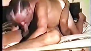 Two men suck each other