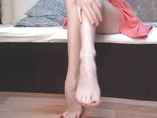 Bikini legs model - Amazing model shows her legs, feet, and white mules. zoom.