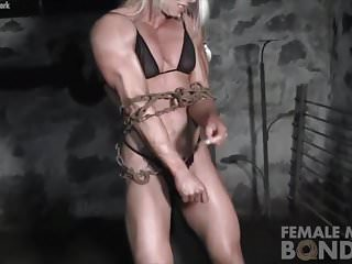 Female bodybuilders adult video Female bodybuilders muscles strain against chains