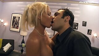 Blonde babe sucks a huge cock while riding another threesome