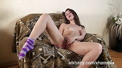 Seta steps out of her clothes and fingers her  hairy pussy.