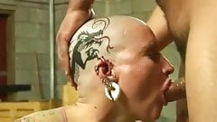 Tattoed pierced bald head slut nailed