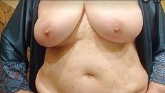 Adorable grandma is showing her huge boobs
