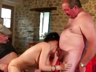 Men playing with breast Two old mature men playing with a young girl