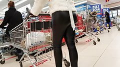 Blonde milf w tight leather leggings at the supermarket