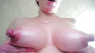 Perky red lactating nipples on preg girl