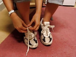 Extreme sneaker fetish - Young blonde girl removing her sneakers and showing her feet