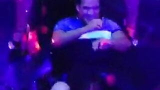 Guy takes a squirt of strippers in a nightclub