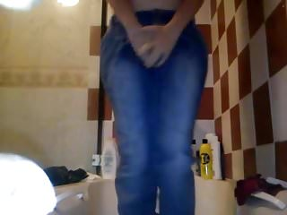 Girls peeing in jean skirts - Nice loose-fitting jeans peeing in bath 1