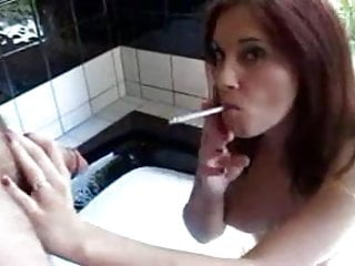 Girls giving a blowjob while driving - Redhead girl is smoking while giving a blowjob