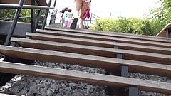 Upskirt woman walk up stairs