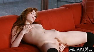 Redhead plunges her fingers into her tight hairy pussy