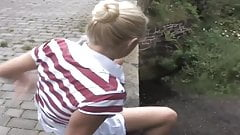 Girl empties her full bladder into the river (Pee)