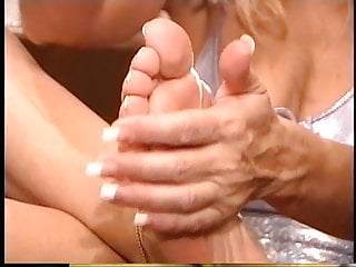 Stockings and open bottom girdles - Sexy blonde with pretty feet slides on white stockings and open toe heels