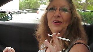 Pretty Grandma smokes in the car