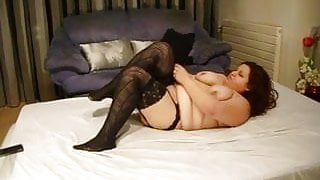 Fat on couch sticks dildo in pussy