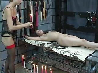 Rough torture porn Young lesbians in the sex dungeon get tortured with hot candle wax and whip
