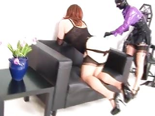 Females dominating males in bondage Female in latex strapon fucks a male in latex