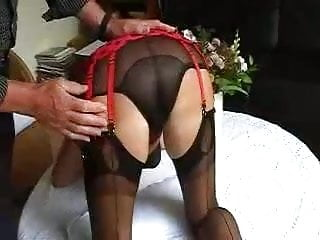 Mature in women in suspenders - 8 strap suspender belt and stockings.