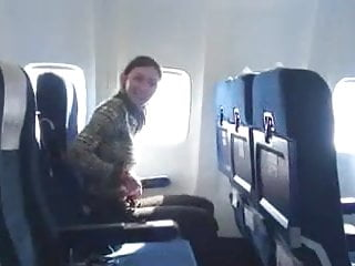 Xtube girl licked on plane - Brunette shows her boobs on plane