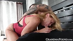 Attractive grandma in lingerie with young muscular dude