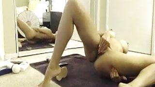 Sexy Asian masturbates on webcam.