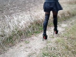 Dressed up in pantyhose - High boots, short dress, legs in pantyhose and strong wind