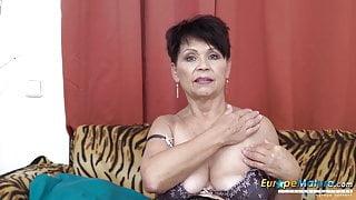 EuropeMature Libi strokes her breast