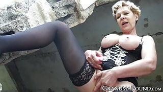 Kinky grandma fucks pussy with dildo in outdoor solo
