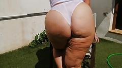Big Sexy Ass Mature Milf getting wet in the garden