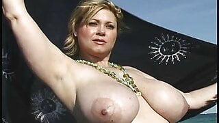 Sexy Samantha 38G sun bath in beach