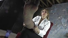 43.  Putting on my very smelly stockings for you.