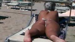 Big ass milf on the beach