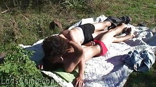 Two cute twinks go for a romp in the sunny meadow