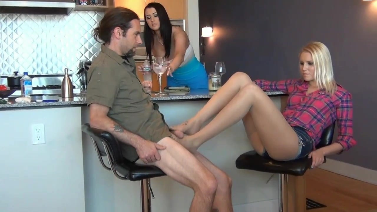 Footjobs under the table