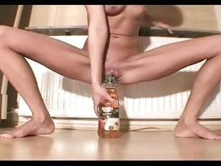 Wife inserting dildo Skinny girl insert huge bottle inside the pussy