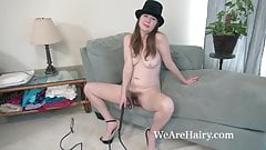 Ophelia Jones strips wearing a black hat and whip