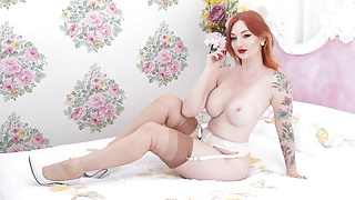 Busty redhead strips off lingerie and wanks in nylons heels