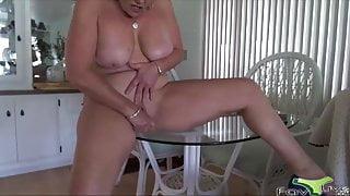Busty mother masturbates on the table