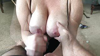 Handjob onto wife's huge freckled tits