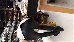 Candid teen bend over in coated black jeans