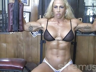 See sexy video Blonde sexy female bodybuilder in see through top works out