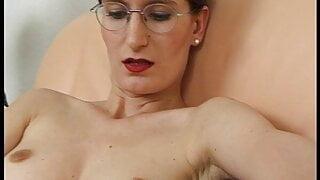Beautiful MILF enjoys having a masturbation session on sofa