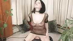 Raven Roxie rides a sex machine touching her natural boobies