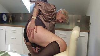 Granny caught masturbating in the kitchen!
