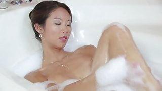 Asian honey with perky tits masturbates in the bathtub