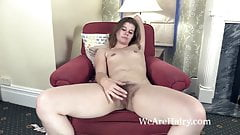 Roxette strips naked on her red armchair