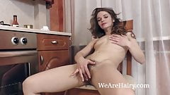 Miranda gets naked in her kitchen and strips naked