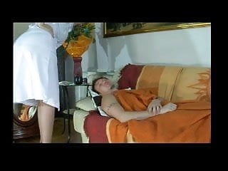 Adult care nursing woodland Russian nurse takes care of young boy bvr