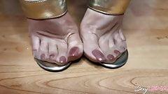 Nylon Feet And Golden Sandals